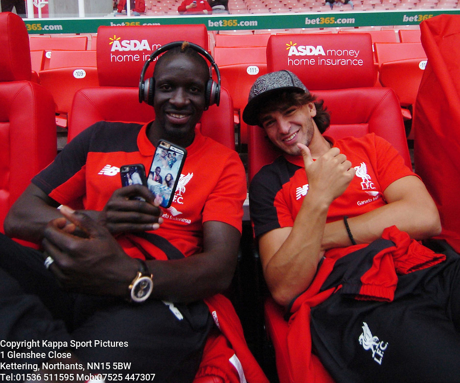 LIVERPOOLS MAMADOU SAKHO & LAZAR MARKOVIC TAKE TIME OUT TO RELAX BEFORE THE GAME IN THE NEW DUGOUT SEATS AT STOKE, Stoke City v Liverpool, Premiership, Britannia Stadium Sunday 9th August 2015