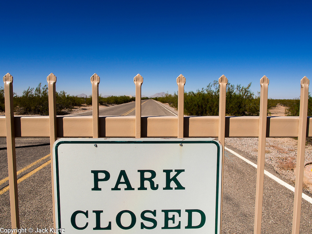 01 OCTOBER 2013 - CASA GRANDE, AZ: The gate to the Casa Grande Ruins in Casa Grande, AZ. The ruins are a US national monument and were closed Tuesday because of the partial shutdown of the US government. All national monuments and national parks were closed Tuesday. The US government closed most non-essential federal services Tuesday. The shutdown is be the first in the US in 17 years. More than 700,000 federal government workers could be sent home on unpaid leave, with no guarantee of back pay once the deadlock is over.  PHOTO BY JACK KURTZ