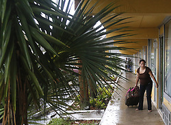 October 7, 2016 - Palm Bay, FL, USA - A resident return back to her room on Oct. 7, 2016 after spending the night in large meeting room near the hotel lobby at the Tropical Inn Resort in Palm Bay, Fla. (Credit Image: © Carl Juste/TNS via ZUMA Wire)