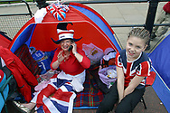Two members of a family who camped out overnight outside Buckingham Palace to secure the best viewing positions for the two-day Golden Jubilee celebrations to mark the 50 year reign of Queen Elizabeth II.Celebrations took place across the United Kingdom with the centrepiece a parade and fireworks at Buckingham Palace, the Queen's London residency. Queen Elizabeth ascended to the British throne in 1952 upon the death of her father, King George VI.
