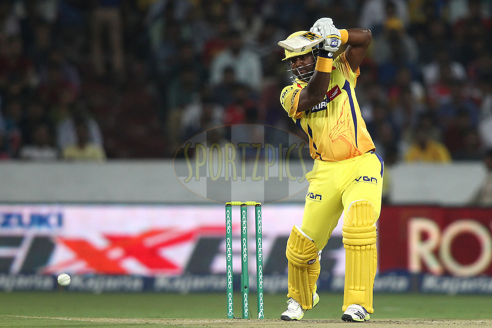 Dwayne Smith of the Chennai Super Kings drives a delivery during the second semi final match of the Oppo Champions League Twenty20 between the Kings XI Punjab and the Chennai Superkings held at the Rajiv Gandhi Cricket Stadium, Hyderabad, India on the 2nd October 2014<br /> <br /> Photo by:  Shaun Roy / Sportzpics/ CLT20<br /> <br /> <br /> Image use is subject to the terms and conditions as laid out by the BCCI/ CLT20.  The terms and conditions can be downloaded here:<br /> <br /> http://sportzpics.photoshelter.com/gallery/CLT20-Image-Terms-and-Conditions-2014/G0000IfNJn535VPU/C0000QhhKadWcjYs