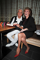 NICKY HASLAM and CILLA BLACK at the launch of his autobiography Redeeming Features held at Aqua Nueva, 240 regent Street, London on 5th November 2009.