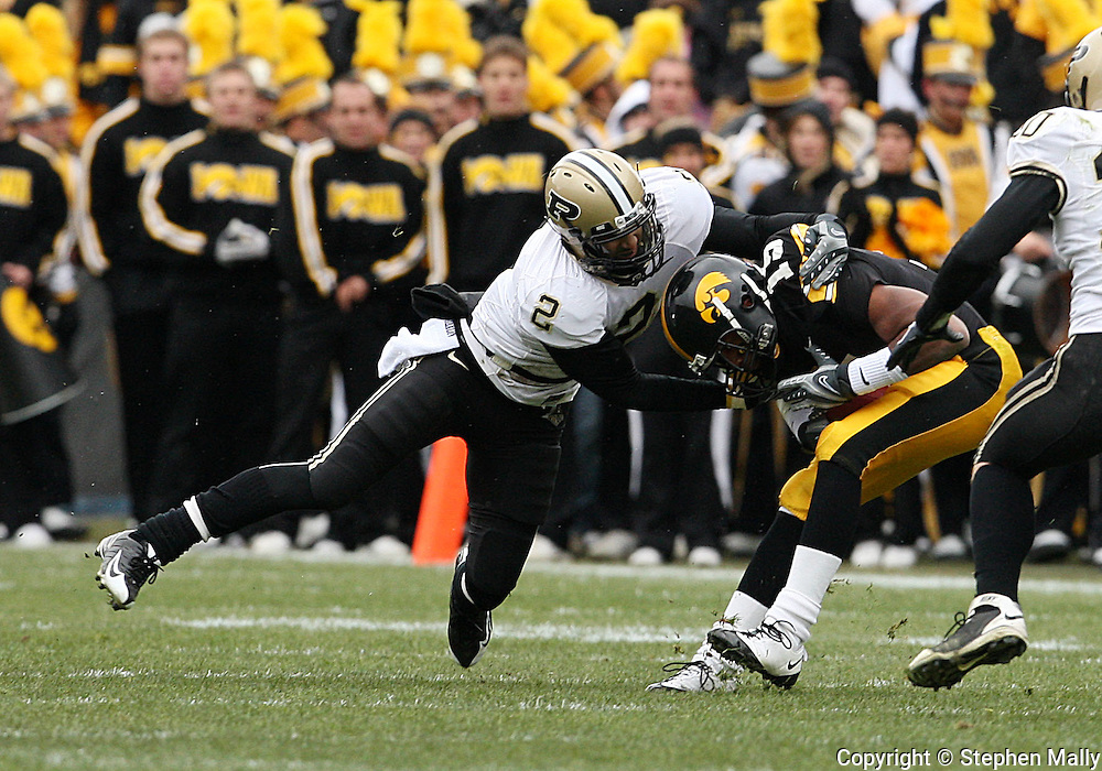 15 NOVEMBER 2008: Iowa wide receiver Derrell Johnson-Koulianos (15) is pulled down by Purdue safety Torri Williams (2) in the first half of an NCAA college football game against Purdue, at Kinnick Stadium in Iowa City, Iowa on Saturday Nov. 15, 2008. Iowa beat Purdue 22-17.