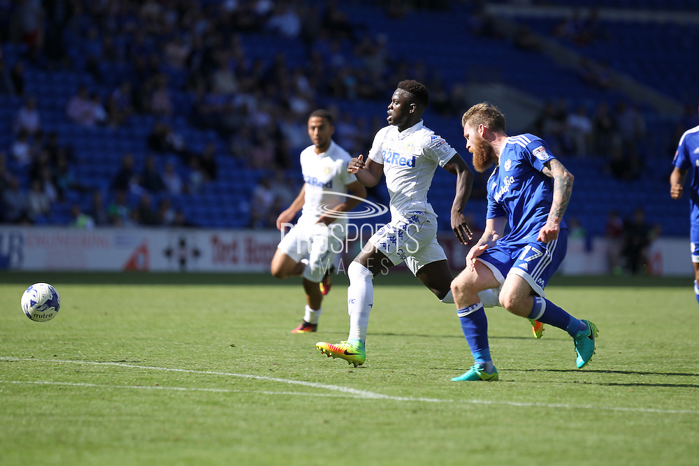 Ronaldo Vieira of Leeds United runs past Aron Gunnarsson of Cardiff City during the EFL Sky Bet Championship match between Cardiff City and Leeds United at the Cardiff City Stadium, Cardiff, Wales on 17 September 2016. Photo by Andrew Lewis.