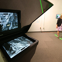 Melissa Scavelli, a student at Mississippi State University in the Meteorology program, reflects in the teleprompter standing in front of the green wall as she gives her weekly broadcast in the studio at Hilbun Hall. Scavelli, is an undergraduate in the program and graduating in May. About half of the nation's broadcast meteorologists come from Mississippi State.