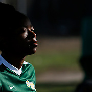 On Friday, November 4, during the Golden West College vs. Fullerton College women's soccer game, Anitonette Harris (6) watches the game from the sideline in Huntington Beach, CA. Golden West College won the game with the final score of 3 to 1.<br /> <br />  Photograph taken by ©Mikailin Rae Perry, Sports Shooter Academy