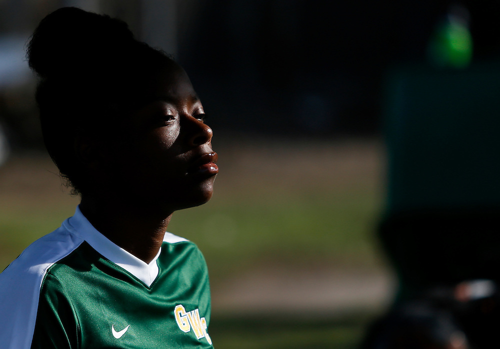 On Friday, November 4, during the Golden West College vs. Fullerton College women's soccer game, Anitonette Harris (6) watches the game from the sideline in Huntington Beach, CA. Golden West College won the game with the final score of 3 to 1.<br /> <br />  Photograph taken by &copy;Mikailin Rae Perry, Sports Shooter Academy