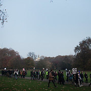 A small group of students go off through Horse Guard parade and St James' Park. Thousands of students turned out to a march against fees and cuts in the education sector, calling for workers ans students to unite againts the Government's austerity policies.