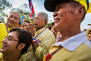 05 MAY 2104 - BANGKOK, THAILAND: Anti-government leader SUTHEP THAUGSUBAN (center) walks among anti-government protesters at Sanam Luang in Bangkok. Thousands of Thais packed the area around Sanam Luang and the Grand Palace Monday evening for a special ceremony to mark Coronation Day, which honored the 64th anniversary of the coronation of Bhumibol Adulyadej, the King of Thailand. Many of the people also support the anti-government movement led by Suthep Thaugsuban. Most of the anti-government protesters are conservative supporters of the monarchy.    PHOTO BY JACK KURTZ