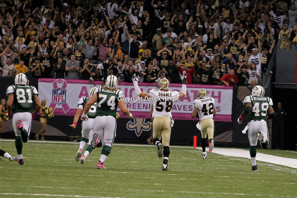 2009 October 04: New Orleans Saints safety Darren Sharper (42) returns a New York Jets quarterback Mark Sanchez (not pictured) interception for a touchdown during the first half of a week four regular season game between the New Orleans Saints and the New York Jets at the Louisiana Superdome in New Orleans, Louisiana.