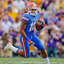 Oct 12, 2013; Baton Rouge, LA, USA; Florida Gators running back Valdez Showers (10) against the LSU Tigers during the second half of a game at Tiger Stadium. LSU defeated Florida 17-6. Mandatory Credit: Derick E. Hingle-USA TODAY Sports