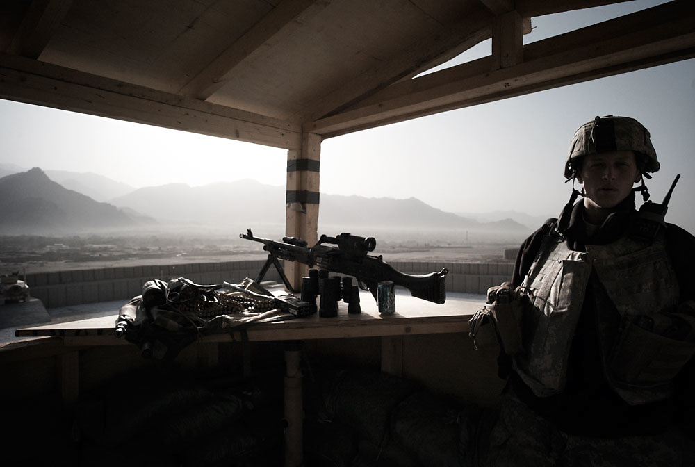 A young soldier on look out duty in the watch tower at Pathfinder base in the Tagab Valley, Kapisa province, Afghanistan on 4th Oct, 2007..