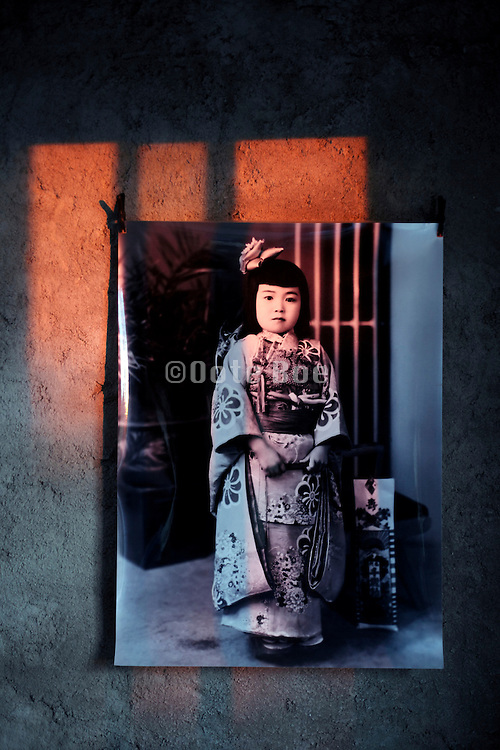 vintage photo of Japanese girl on wall with the light of warm sun rays