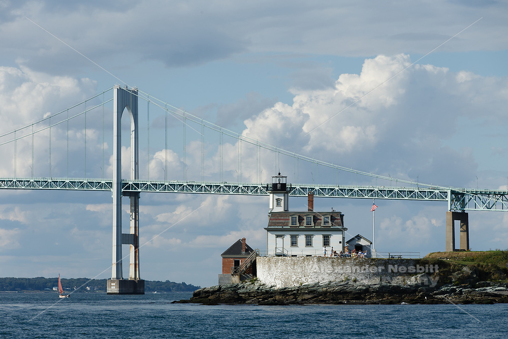 Newport, RI - The Rose Island light house in a brilliant summer day with puffy clouds
