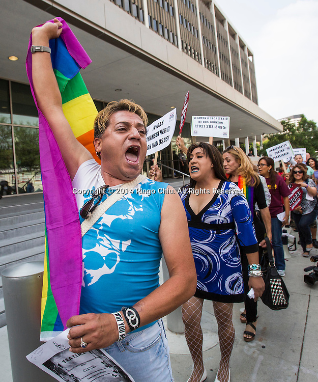 A coalition of LGBT, immigrant and civil rights organizations rally in front of the Los Angeles Immigrations and Customs Enforcement district office to protest the rape of a transgender woman who was housed with men in a detention center in Arizona, Thursday, August 7, 2014, in Los Angeles, California.  Marichuy Leal Gamino is a 23-year-old transgender woman who has spent more than a year living in an immigration detention facility, housed with men. Though she spent most of her life growing up in Arizona, she was born a Mexican citizen, making her an undocumented immigrant. After repeatedly experiencing harassment and threats of abuse, she says she was sexually assaulted last week by her cellmate. When she reported the abuse to the staff of the for-profit facility, they allegedly responded by asking her to sign a statement claiming that she had consented. The group request that DHS Secretary Jeh Johnson order the release and care of Marichuy Leal Gamino.<br />  (Photo by Ringo Chiu/PHOTOFORMULA.com)