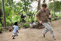 MISSION OF COMPASSION (CHASE)<br /> Brian Combs a therapist from Vaughn, Wash. visits his sixth orphanage in five days along Sri Lanka's eastern and southern shores and plays chase with four-year-old, Sajith.  After witnessing lives forever marked by the massive destruction of the tsunami, Combs found playing with the children as therapeutic for himself as for the 4-year-old.
