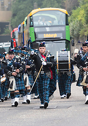 Military Tattoo pipers unveil new open-top tour buses. Lothian Buses has invested in 30 new open-top double deck vehicles for Edinburgh Bus Tours. The buses will begin operating across three of its routes in the coming weeks.<br /> <br /> <br /> (c) Richard Dyson| Edinburgh Elite media