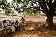 A health worker is installed under a tree where woman can come have their children vaccinated during a national polio immunization exercise in Salaga, northern Ghana on Thursday March 26, 2009.