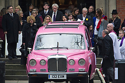 © London News Pictures. 13/02/2014. London, UK. Emily Lloyd-Pack (left) standing next to the hearse as it leaves the church.  The funeral of actor Roger Lloyd-Pack at St Pauls Church also known as 'The Actor's Church'  in Covent Garden, London. Roger Lloyd-Pack was famous for playing roles such as Trigger in Only Fools and Horses and Owen Newitt in the The Vicar of Dibley. Photo credit : Ben Cawthra/LNP