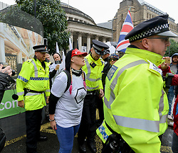 Pictured: A protester is led away by police after being arrested outside the conference venue.<br /> <br /> protesters demonstrated on the first day of the Conservative Party conference in Manchester.<br /> <br /> © Dave Johnston / EEm