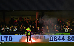 A flare is extinguished during the Emirates FA Cup, first round match at Ewen Fields, Hyde.