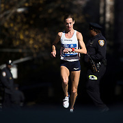 NYTRUN - NOV. 6, 2016 - NEW YORK - Molly Huddle of the United States, making her marathon debut, checks her watch as she runs south along 5th Avenue, just north of E 90th Street, as she competes in the 2016 TCS New York City Marathon on Sunday. She finished third in 2:28:13. NYTCREDIT:  Karsten Moran for The New York Times **PLS CHECK FINISH PLACE AND TIMES