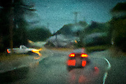 A Droid smart phone capture of traffic in an abstract representation of rain retruning to western Washington state as the wet season starts.