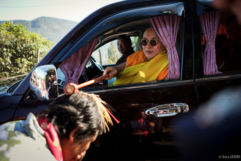 Blessing ceremony  of the head of the Buddhism on the road to the winter monastery in a village of Punakha Valley, Bhutan, Asia