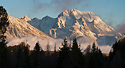 Sunrise on Mount Moran dusted with fresh snow, Grand Teton National Park, Wyoming, USA. The panorama was stitched from two overlapping photos.