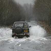 8.1.2005....Road closed...exept for 4x4 drivers as the  B846 Aberfeldy to Weem road looks more like a river.<br />