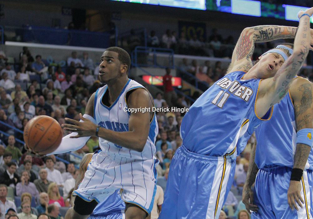 25 March 2009: New Orleans Hornets guard Chris Paul (3) drives past Denver Nuggets center Chris Andersen (11) drawing a foul on the play during a 101-88 loss by the New Orleans Hornets to the Denver Nuggets at the New Orleans Arena in New Orleans, Louisiana.