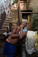 PANAMA, PANAMA - SEPTEMBER 21: Young boys posing with attitude at the stairs of a condemned building. September 21, 2011.  Panama, Panamá. (Photo: Rubén Alfú / Istmophoto)