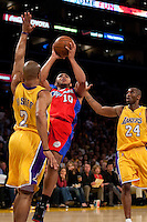 15 January 2010: Guard Eric Gordon of the Los Angeles Clippers shoots the ball over Derek Fisher of the Los Angeles Lakers during the first half of the Lakers 126-86 victory over the Clippers at the STAPLES Center in Los Angeles, CA.