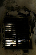 Light enters a window in an old deserted and dilapidated building. Photographed in Abu Gosh, Israel