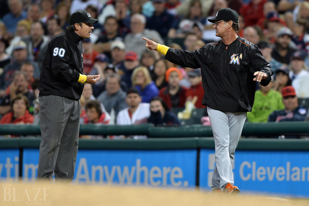 Sep 2, 2016; Cleveland, OH, USA; Miami Marlins manager Don Mattingly (8) argues with umpire Mark Ripperger (90) during the ninth inning against the Cleveland Indians at Progressive Field. Mandatory Credit: Ken Blaze-USA TODAY Sports