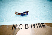 """Josha Mormant, 10, does a """"twist,"""" a trick where he spins around in the water, in the May Park Pool in Augusta July 22, 2008. Richmond County Pools close next week. The last day to swim is August, 1, 2008. KENDRICK BRINSON/STAFF"""