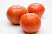 3 fresh, ripe Red tomato on white background