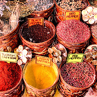 Display of Various Saffron and Pepper in Marmaris, Turkey<br /> This display at a market in Marmaris, Turkey, specializes in two spices.  The first is Turkish and Indian saffron, which has been used for over 4,000 years for everything from a medicine, dye, bathing agent, aphrodisiac and, oh yeah, to add aroma and flavor to food.  It is extremely expensive because it takes about twenty hours to harvest the 50,000 to 75,000 crocus flowers to produce a single pound.  The second is pepper.  The black is when the unripen peppercorns are cooked and dried, the white is only the plant's seed, and the red are usually processed in vinegar and brine.  The origin of pepper is traceable to southern India at least a thousand years B.C.