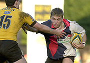 29/02/2004  -  Powergen  Cup - London Wasps v Pertemps Bees .Bees Dave Knight is tackled by Wasps Tom Voyce.   [Mandatory Credit, Peter Spurier/ Intersport Images].