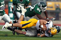 12 November 2011:  Chris Rice flies in just in time to help complete the stop on David Lee during an NCAA division 3 football game between the Augustana Vikings and the Illinois Wesleyan Titans in Tucci Stadium on Wilder Field, Bloomington IL