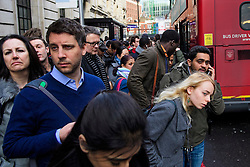 © Licensed to London News Pictures. 09/01/2017. London, UK.  A group of commuters wait to board a bus at Victoria station in London on the second day of a 24 hour tube strike.  All Zone one tube stations are closed until 6PM tonight after members of the RMT and the Transport Salaried Staffs' Association unions walked out after talks with TFL collapsed. Photo credit: Ben Cawthra/LNP