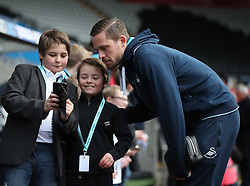 Swansea City's Gylfi Sigurdsson poses for photos prior to the Premier League match at the Liberty Stadium, Swansea.