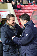 Swindon Town manager, Mark Cooper & Crawley Town manager, Dean Saunders during the Sky Bet League 1 match between Swindon Town and Crawley Town at the County Ground, Swindon, England on 21 February 2015. Photo by Shane Healey.