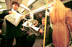 UK ENGLAND LONDON 13MAR02 - Commuters read newspapers on an overcrowded London underground Circle Line train. ..The London Underground is a rapid transit system serving a large part of Greater London and neighbouring areas of Essex, Hertfordshire and Buckinghamshire in the UK. The Underground has 270 stations and about 400 km of track, making it the longest metro system in the world by route length; it also has one of the highest number of stations and transports over three million passengers daily...jre/Photo by Jiri Rezac..© Jiri Rezac 2002