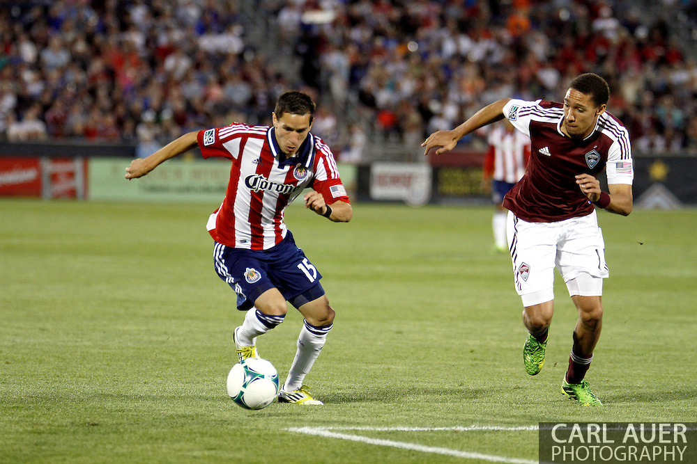 May 25th, 2013 Commerce City, CO - Chivas USA midfielder Eric Avila (15) brings the ball towards the goal against Colorado Rapids defender Chris Klute (15) in the second half of the MLS match between Chivas USA and the Colorado Rapids at Dick's Sporting Goods Park in Commerce City, CO
