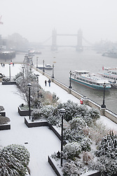 © Licensed to London News Pictures. 20/01/2013. London, UK. The Thames path is  covered by a blanket of snow on 20 January 2013. Heavy snow has hit London and is forecast to continue for the next four days. Photo credit : Vickie Flores/LNP
