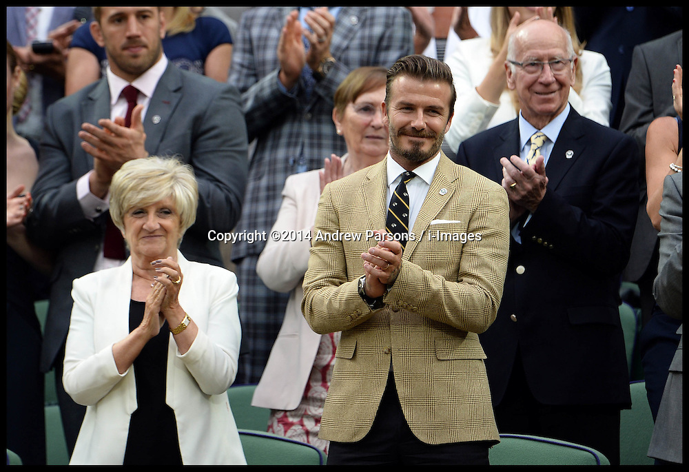 Image ©Licensed to i-Images Picture Agency. 28/06/2014, Wimbledon, London, United Kingdom. David Beckham with his mum Sandra  in the Royal box on Day 6 of the Wimbledon Tennis Championship. Picture by Andrew Parsons / i-Images