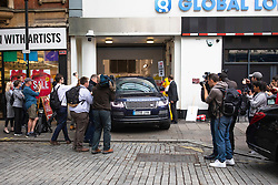 © Licensed to London News Pictures. 25/06/2019. London, UK. A four wheel drive carrying Boris Johnson MP, the frontrunner to be the next Leader of the Conservative party, is surrounded by photographers as it leaves a radio studio in central London. Boris Johnson is now believed to have police protection after he made it to the final two candidates in the Conservative leadership race. Photo credit: Rob Pinney/LNP
