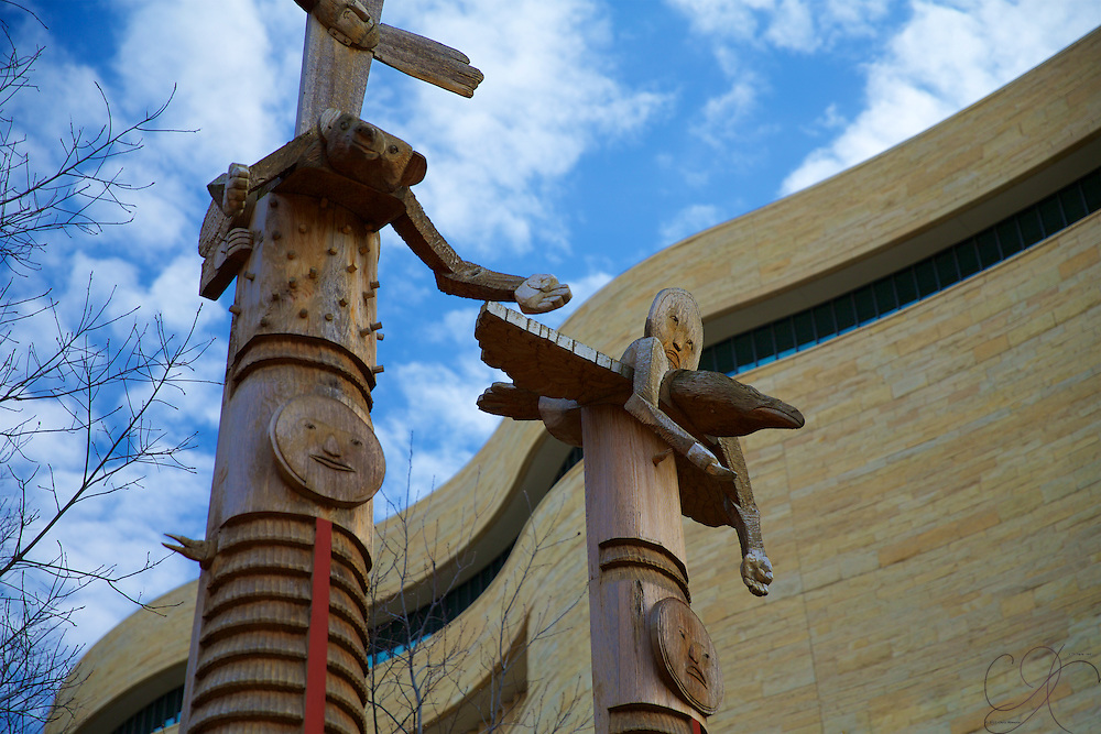 Totem poles on the northwestern side of the National Museum of the American Indian begin to tell a story before you go inside.