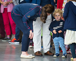 © London News Pictures. 26/07/2015. CATHERINE, Duchess of Cambridge talks to the families of crew members during a visit to Land Rover BAR (Ben Ainslie Racing) in Portsmouth, South Hampshire, as part of a visit to the America's Cup World Series with Prince William. Photo credit: Ben Cawthra/LNP